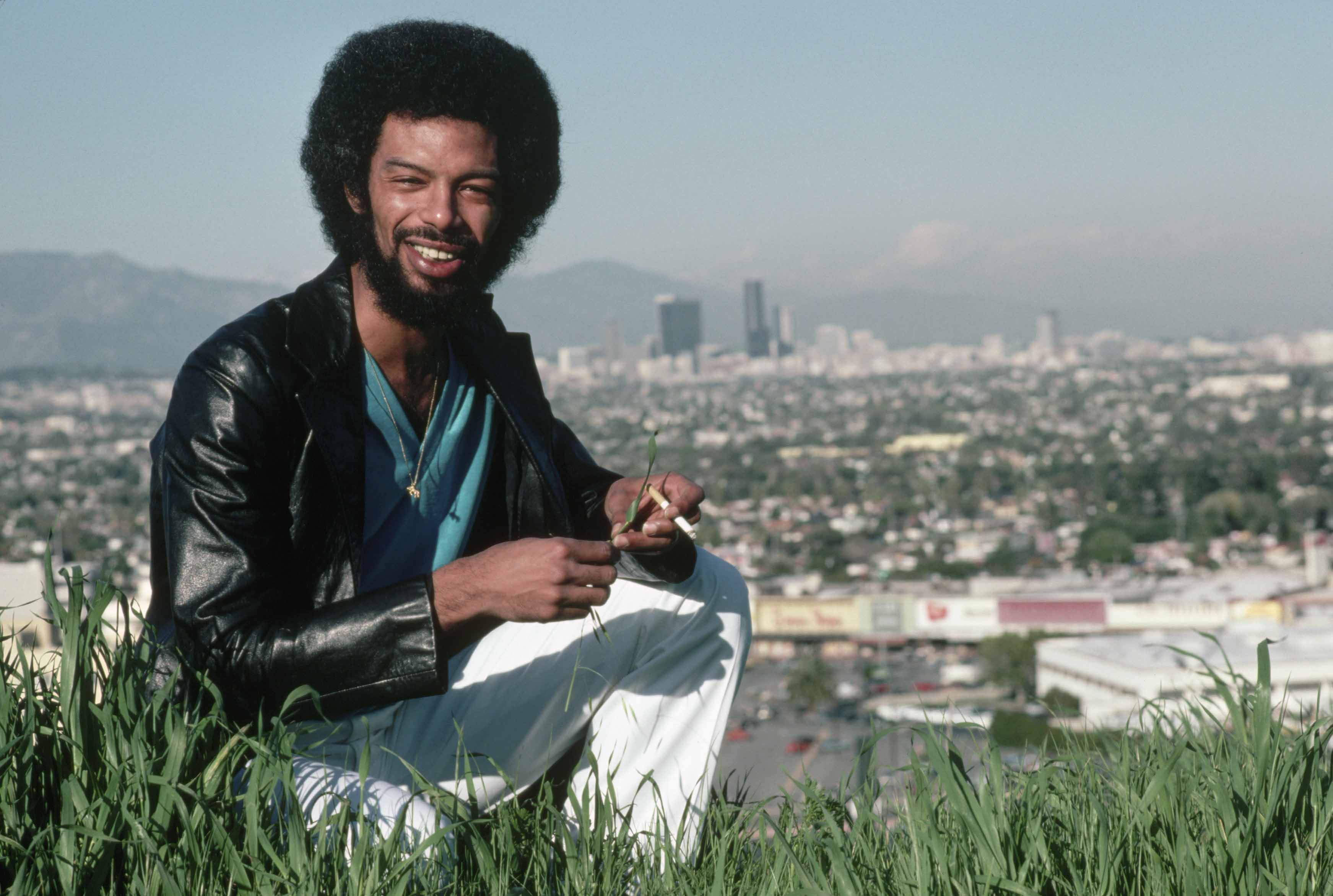 Gil Scott-Heron Kneeling in Grass